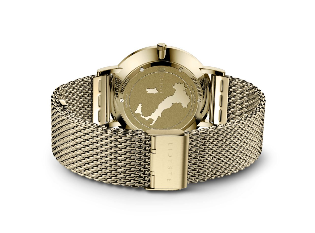 engraved case back of gold mesh watch