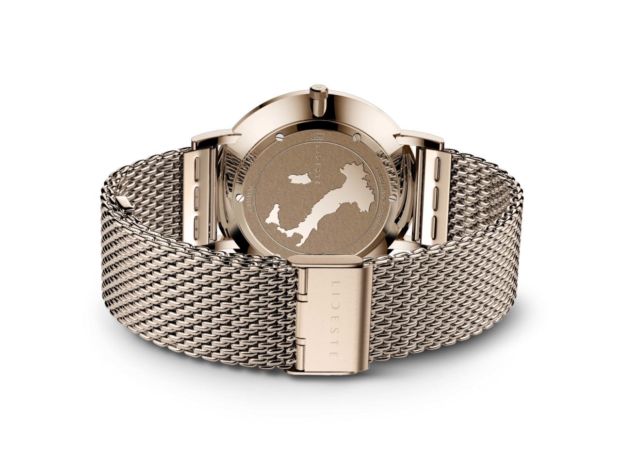 engraved case back of rose gold mesh watch