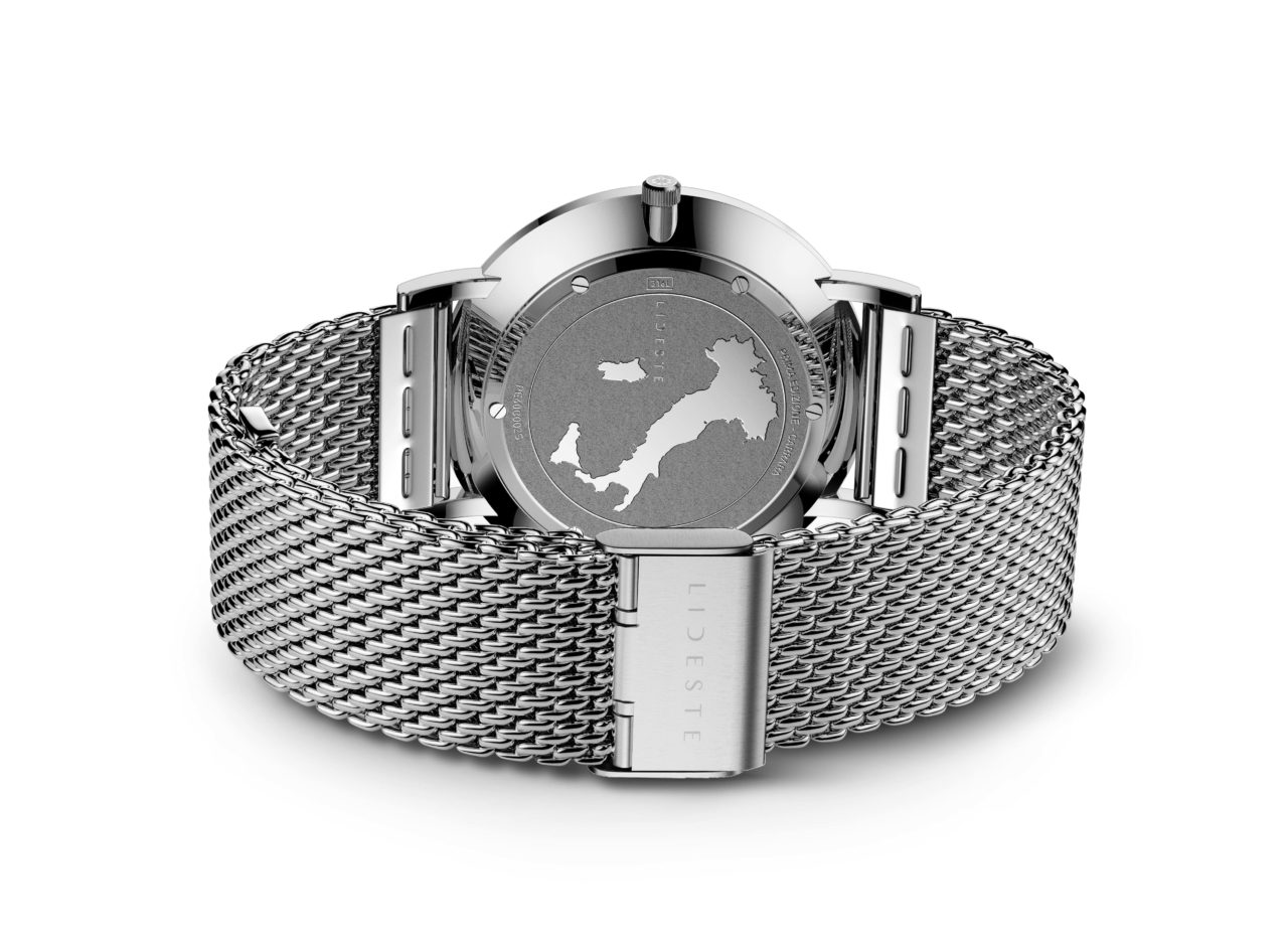 engraved case back of silver mesh watch