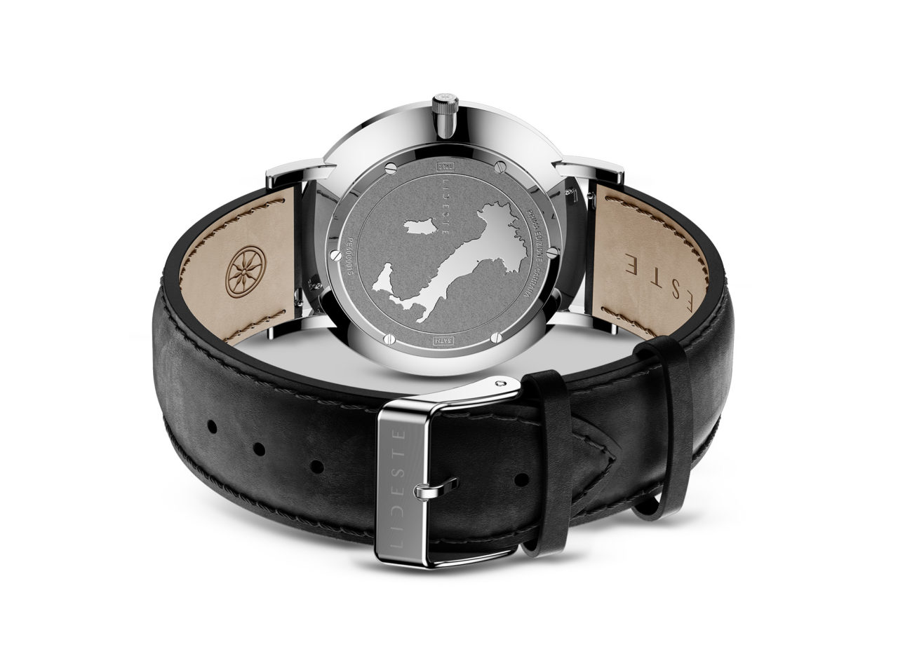 engraved case back of black leather watch